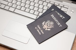 Two Passports on Laptop Computer