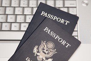 Two Passports on a Laptop Computer