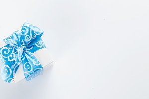 wite gift box with blue ribbon
