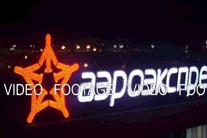 Aeroexpress banner in Sheremetyevo Airport at night
