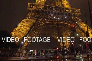 Under illuminated Eiffel Tower at night