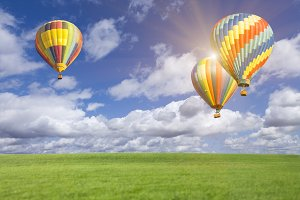 Two Hot Air Balloons and Blue Skies
