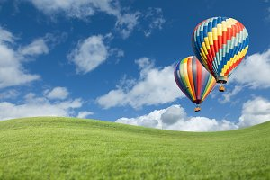 Two Hot Air Balloons Up in Blue Sky
