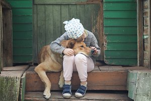 Amazingly cute child and huge dog