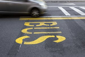 Yellow bus sign on the asphalt