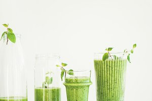Matcha green smoothie with chia seeds in glasses, copy space