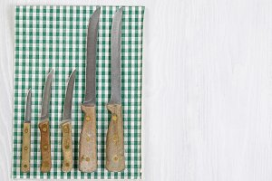 Vintage Knife Set on white wood