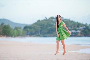 Young beautiful woman having fun on tropical seashore.
