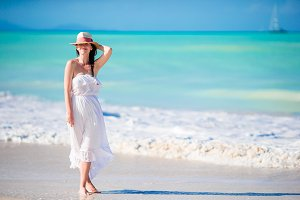 Caucasian girl with hat background the sea