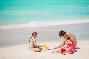 Father and little kids enjoying beach summer tropical vacation.