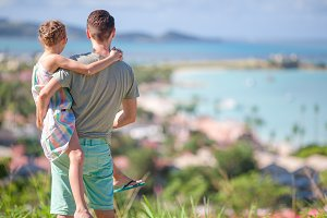 Young father and little girl enjoying beautiful views of exotic island