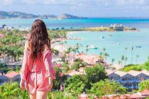 Young tourist woman with view of bay at tropical island in the Caribbean Sea