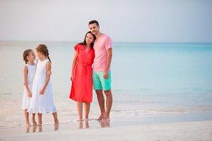 Happy beautiful family on the beach