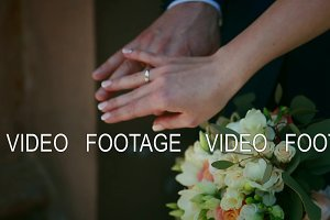 slowly, close up, bride with groom, wedding rings on hands