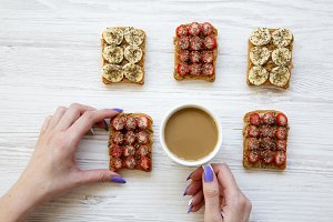 Woman's hands holding vegan toast