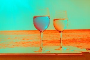Two glasses by sea blue and orange