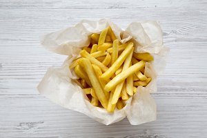 Top view, french fries over white