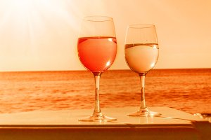 Two glasses by sea in orange