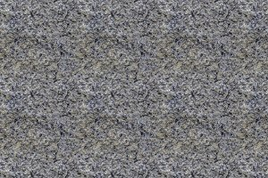 A seamless pattern texture of natural gray granite stone