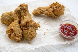 Fried chicken legs with ketchup