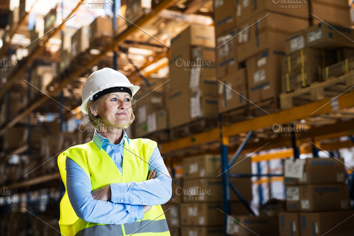 Senior woman manager or supervisor standing in a warehouse, arms crossed. in Graphics - product preview 8