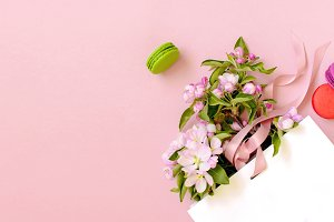 White gift bag with spring flowers