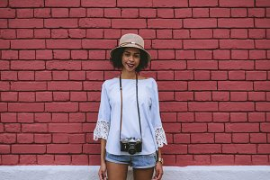 Black girl in front of brick wall