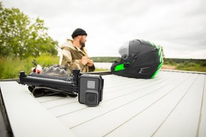 View of sports ation camera with mount with motorcycle helmet an