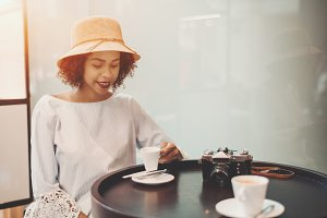 Black girl in cafe with coffee