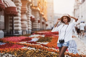 Afro girl on street with flowerbeds
