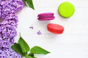 Sweet macaroons and lilac flowers