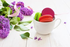 White cup with sweet macaroons