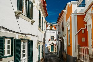 Old and quaint cobblestone street in Cascais, Portugal