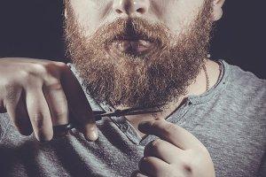 man cuts his beard