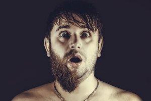 shocked half-shaven man