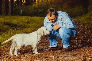 Golden retriever puppy with man
