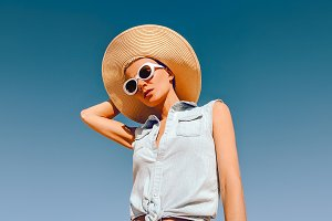 Girl in fashion accessories. Hat and