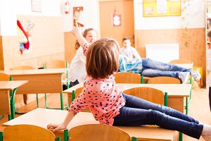 pupils are sitting on the desk after classes