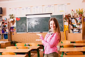 Young woman teacher in the classroom