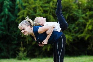 Sporty mother and daughter training