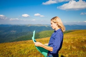 The woman studies terrain terrain