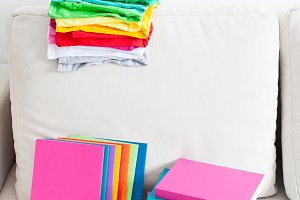 many color tshirts and books