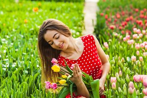 Beautiful woman with colourfull tulips