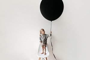 Little girl with large balloon