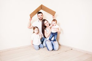 Happy young family under a safe roof, concept