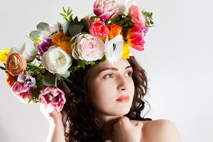 happy woman with wreath of flowers