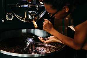 Woman controlling quality of coffee