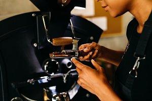 Unrecognizable woman checking coffee