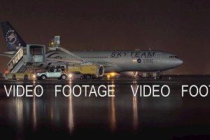 Airplane of SkyTeam livery in Sheremetyevo Airport at rainy night