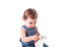 beautiful little baby with a book
